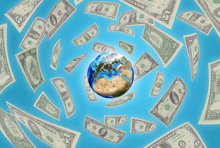 Planet earth on a blue background  Money falling around photo