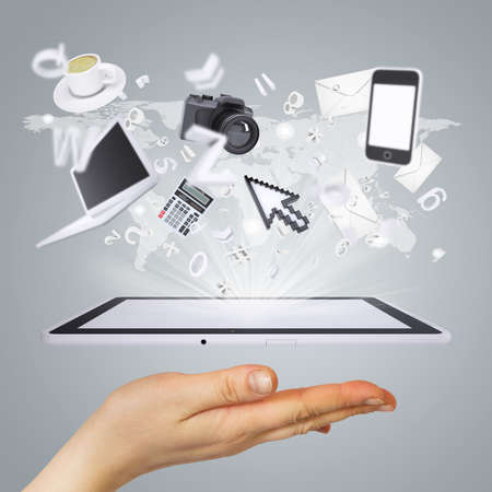 Hand holding tablet pc  Electronics are emitted from the screen tablet  The concept of electronics photo