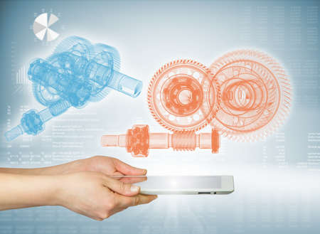 Hands holding a tablet  Above the screen of the tablet are gears  Hi-tech background photo