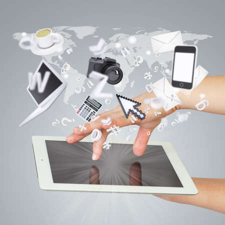Hands holding tablet pc  Electronics are emitted from the screen tablet  The concept of electronics photo