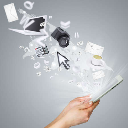 Hands holding tablet pc  Electronics are emitted from the screen tablet. The concept of electronics photo
