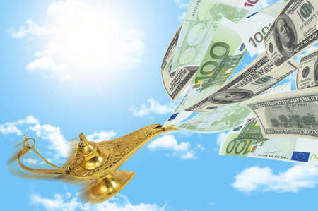 Money fly out of Aladdin magic lamp photo