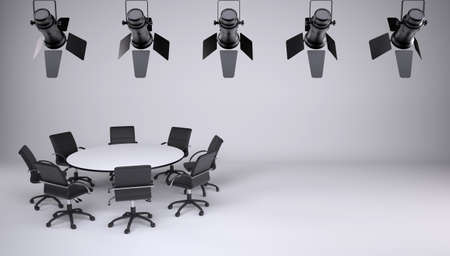studio lighting: Round table and eight office chairs on a gray background  On the ceiling of the studio lighting lamps  Cooperation concept Stock Photo