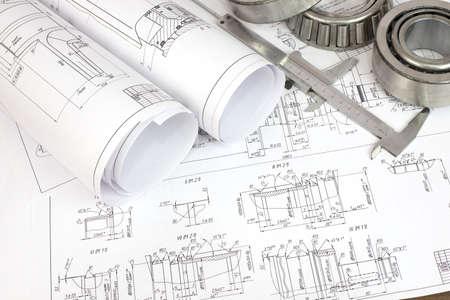 Bouwtekeningen, remklauw en lager Desk Engineer Stockfoto