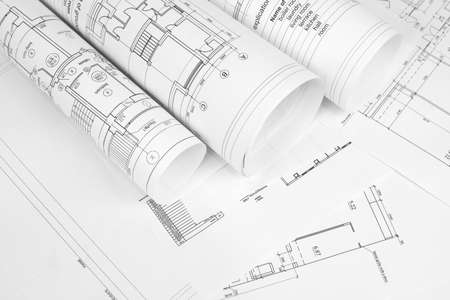 Scrolls of architectural drawings  The desk architect Stock Photo