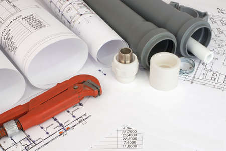 sewerage: Plumbing tools on the construction drawings  Repair and construction of plumbing system Stock Photo