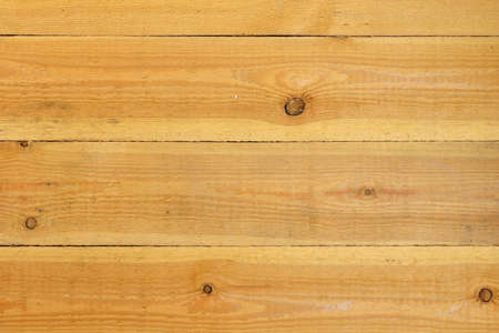 unprocessed: Surface unprocessed wooden planks  The construction material