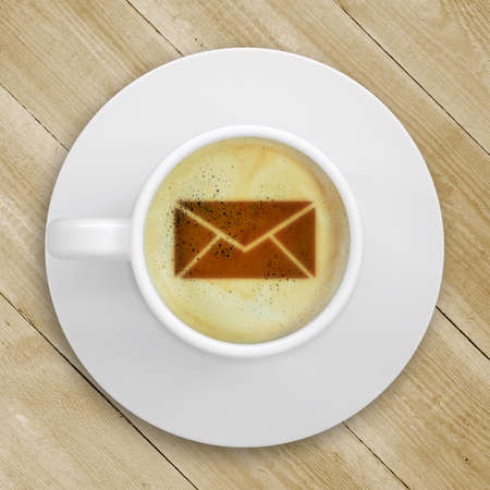 Cup of coffee standing on a wooden surface  Picture of the mail in the coffee crema  top view photo