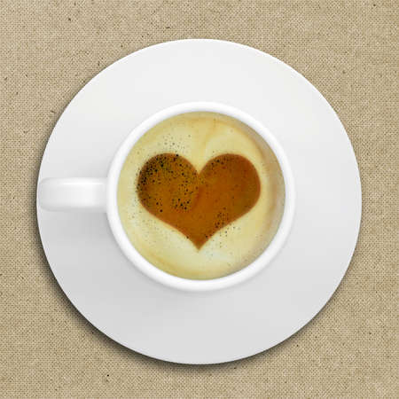 Cup of coffee standing on a wooden surface  Picture of the heart in the coffee crema  top view photo