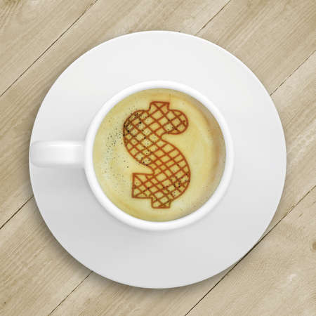 crema: Cup of coffee standing on a wooden surface  Picture of the dollar sign in the coffee crema  top view