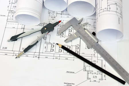 construction plans: Scrolls architectural drawings and tools of the architect  Desk architect Stock Photo