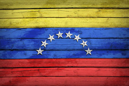 venezuelan: Venezuelan flag painted on wooden boards  Grunge style Stock Photo