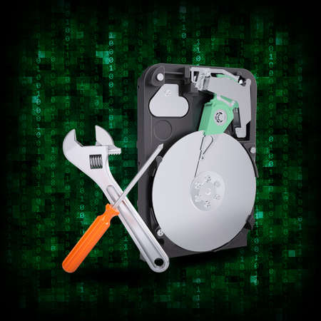 Abstract background  HDD with magnifying glass and adjustable wrench  Electronic concept photo