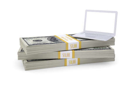 Laptop stand on pack of dollars  White background photo