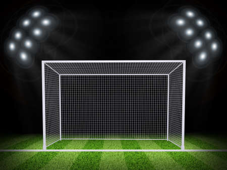 Night football arena illuminated by spotlights  Soccer gate in the middle of field  Sports background photo