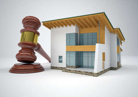 Gavel and small house  The gray background photo