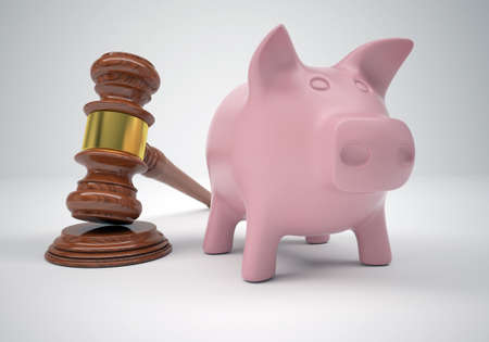 Gavel and piggy bank  The gray background photo