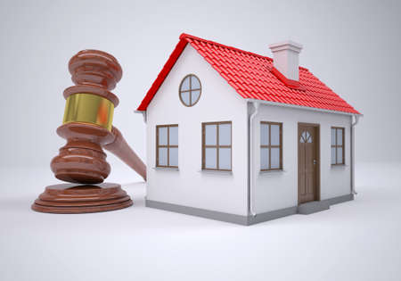 Gavel and small house  The gray background