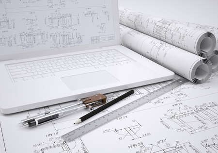 engineering drawing: Scrolls engineering drawings and laptop  Desk Engineer