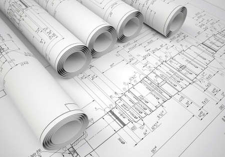 Several scrolls engineering drawings on the drawing  Desk Engineer Stock Photo