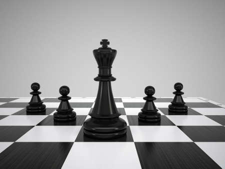 chess king: Black chess king and pawns  gray background Stock Photo