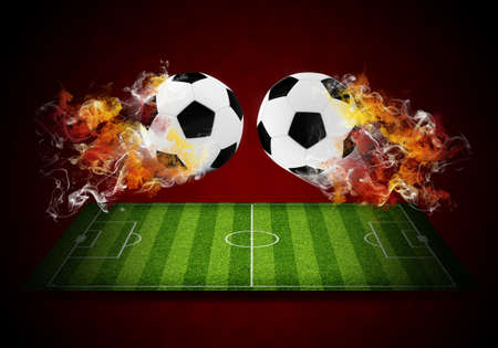 Two soccer balls in the color of flame and smoke  Sport concept photo
