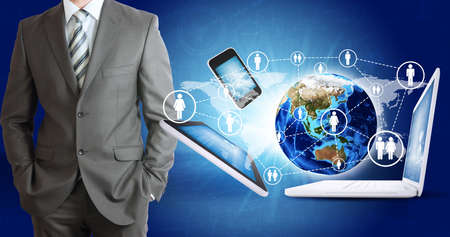 Businessman in suit  Earth and electronics  Elements of this image are furnished by NASA photo