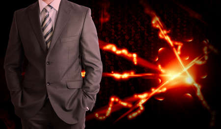 Businessman in a suit and glow rays  Business concept photo