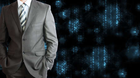 Businessman in a suit with background of blue glowing figures photo