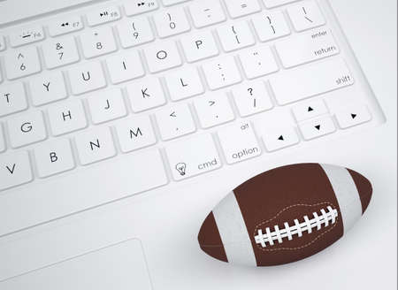 pumped: American football ball on the keyboard  View from above Stock Photo