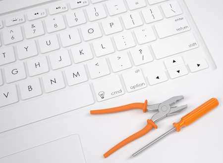 slotted: Pliers and screwdriver on the keyboard  View from above