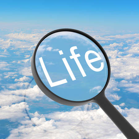 Magnifying glass looking Life  Clouds on background  Business concept photo