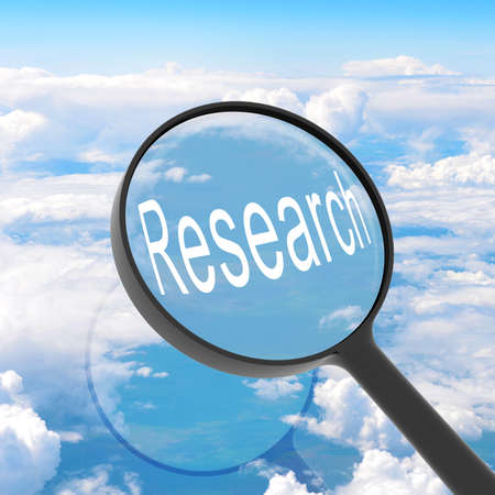 Magnifying glass looking Research  Clouds on background  Business concept photo