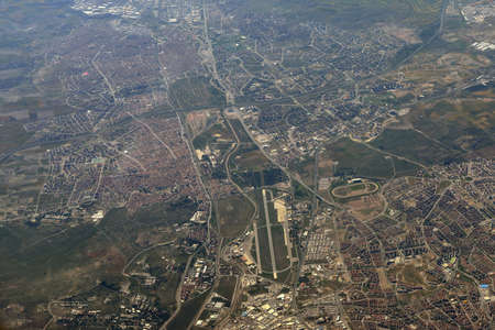 Aerial view of the city  Buildings, fields, trees and roads photo