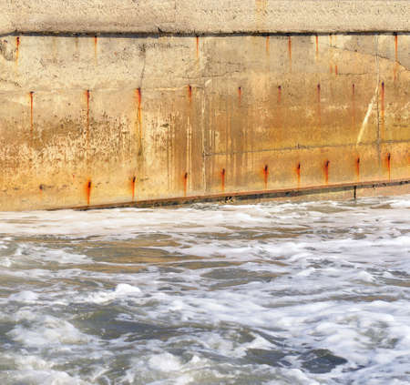 seawater: Seawater and the old concrete wall  Water obstacle Stock Photo