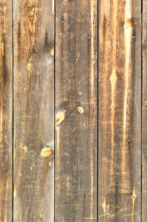 distressed wood: Painted wooden boards with nails  The orange color