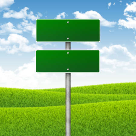 Crossroads road sign  Green grass and blue sky as backdrop photo