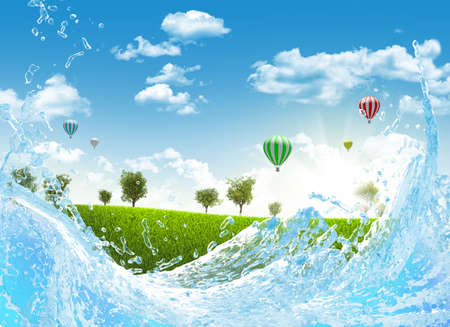 Trees on green meadow and water splash  Hot Air Balloon in the sky photo