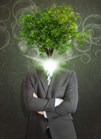 Businessman stand with green tree instead his head photo