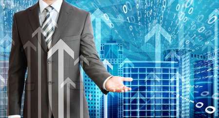 Businessmen with skyscrapers, graphs and arrows photo