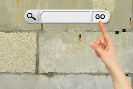 Human hand indicates the search bar in browser photo