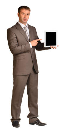 Businessman holds tablet pc photo