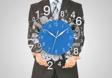 magic hour: Businessman hold clock Stock Photo