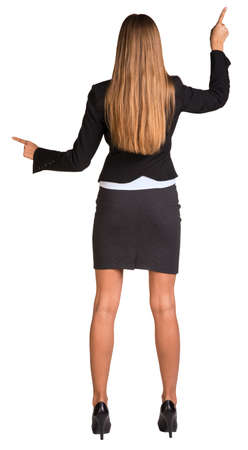 Businesswoman pushing fingers in opposite directions photo
