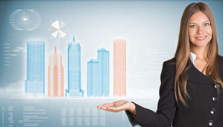 Businesswoman with high-tech skyscrapers and graphs photo
