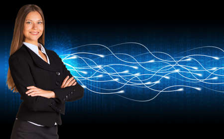 Businesswoman in a suit and glow rays photo