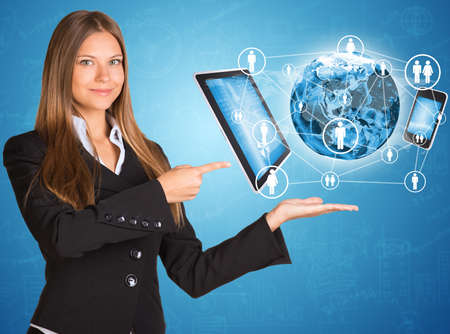 Businesswoman in suit  Earth and electronics photo