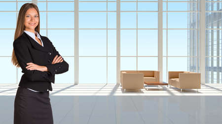 Businesswoman and large window in office building photo