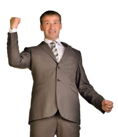 Joyful businessman raised his hands up photo