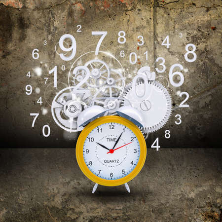 Alarm clock with white figures and gears photo